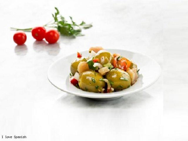 Hiszpańskie zielone oliwki z miodem, słodkim sokiem pomarańczowym i selerem